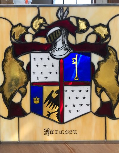 Family crest created in stained glass using acid burning on flash glass