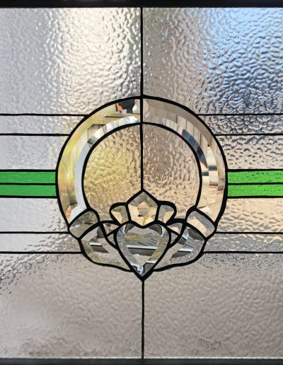 Stained glass window with Irish Claddagh design for a residence